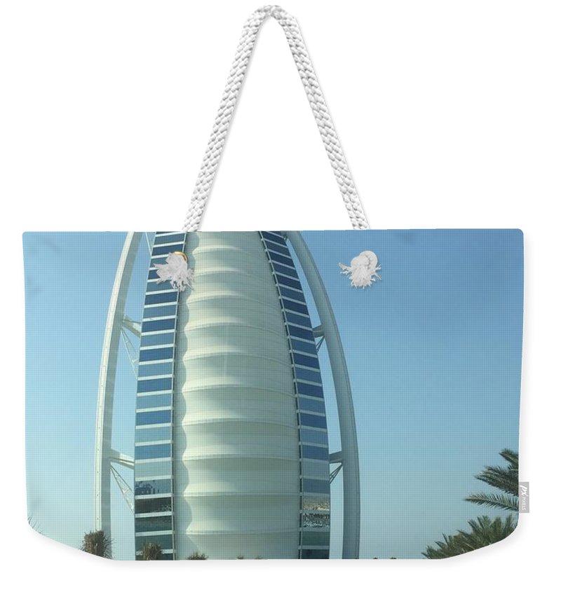 Weekender Tote Bag featuring the photograph Sail-shaped Silhouette Of Burj Al Arab Jumeirah by Chris Hood