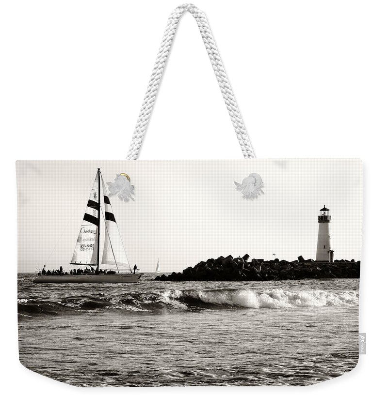 Santa Cruz Weekender Tote Bag featuring the photograph Sailboat And Lighthouse 2 by Marilyn Hunt