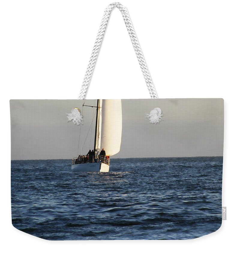 Sail Weekender Tote Bag featuring the photograph Sailboat Coming Ashore 1 by Marilyn Hunt