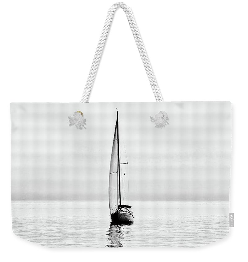 Sea Weekender Tote Bag featuring the digital art Sailboat On Calm Waters And Foggy Weather by Luisa Vallon Fumi