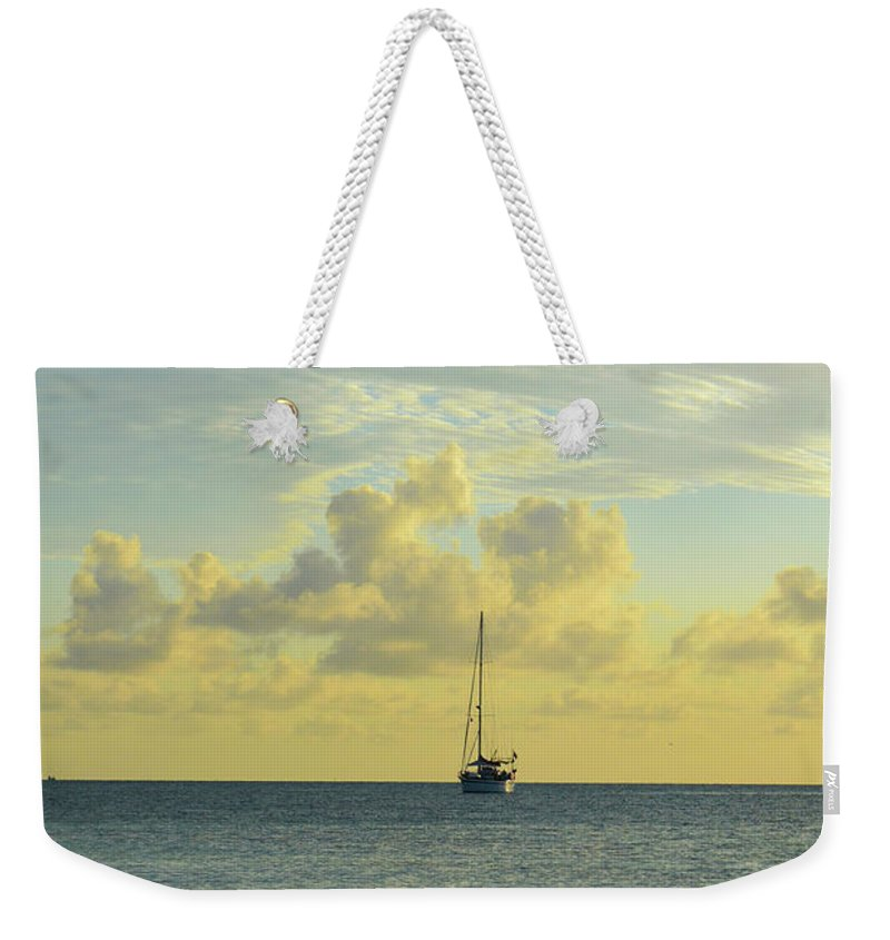 Florida Weekender Tote Bag featuring the photograph Sailboat On The Horizon by Kylee S