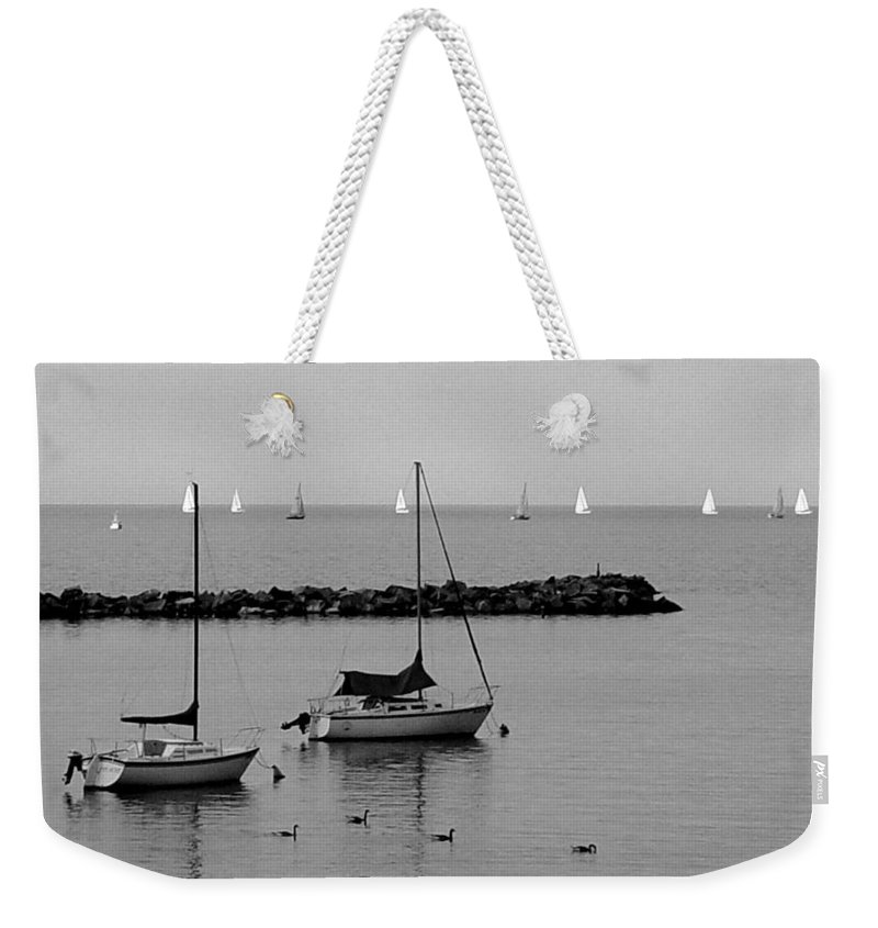 Sailboats Weekender Tote Bag featuring the photograph Sailboats And Ducks B-w by Anita Burgermeister