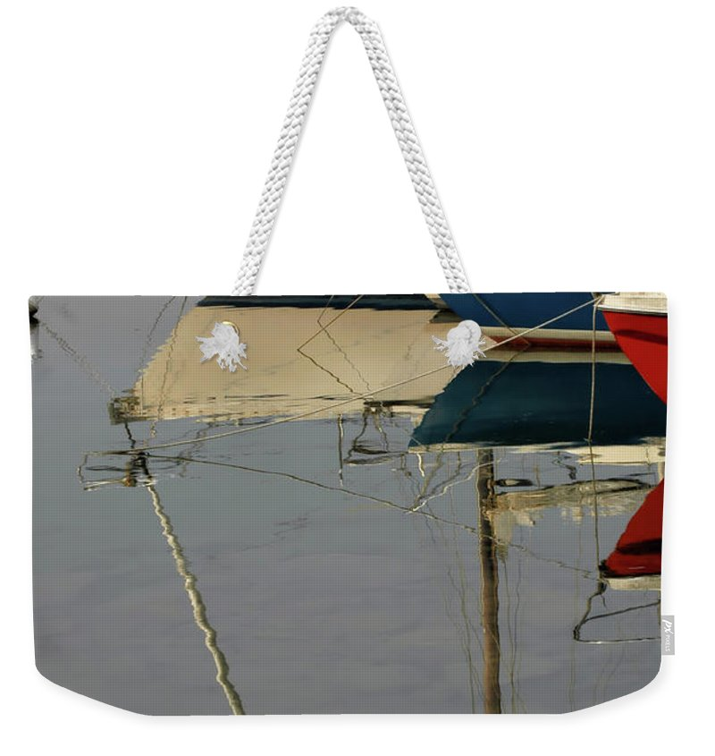 Boats Weekender Tote Bag featuring the photograph Sailboats And Reflections by Guido Strambio