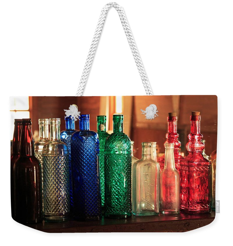 Bottles Weekender Tote Bag featuring the photograph Saloon Bottles by Toni Hopper