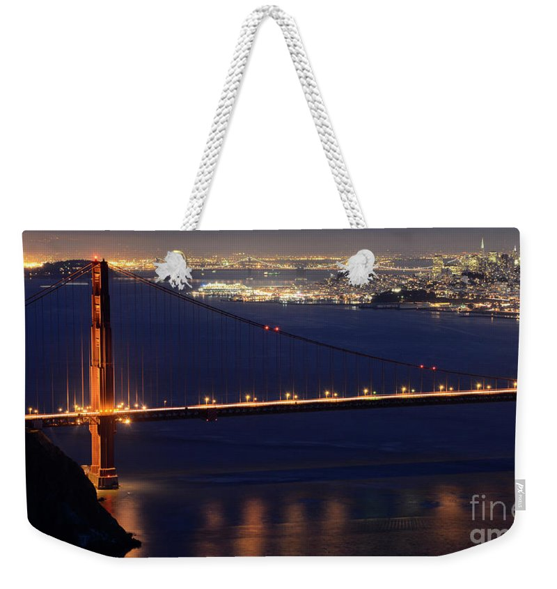 San Francisco Weekender Tote Bag featuring the photograph San Francisco At Night by Bob Christopher