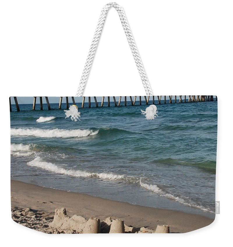 Sea Scape Weekender Tote Bag featuring the photograph Sand Castles And Piers by Rob Hans