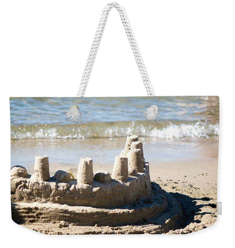 Sand Weekender Tote Bag featuring the photograph Sandcastle by Lisa Knechtel