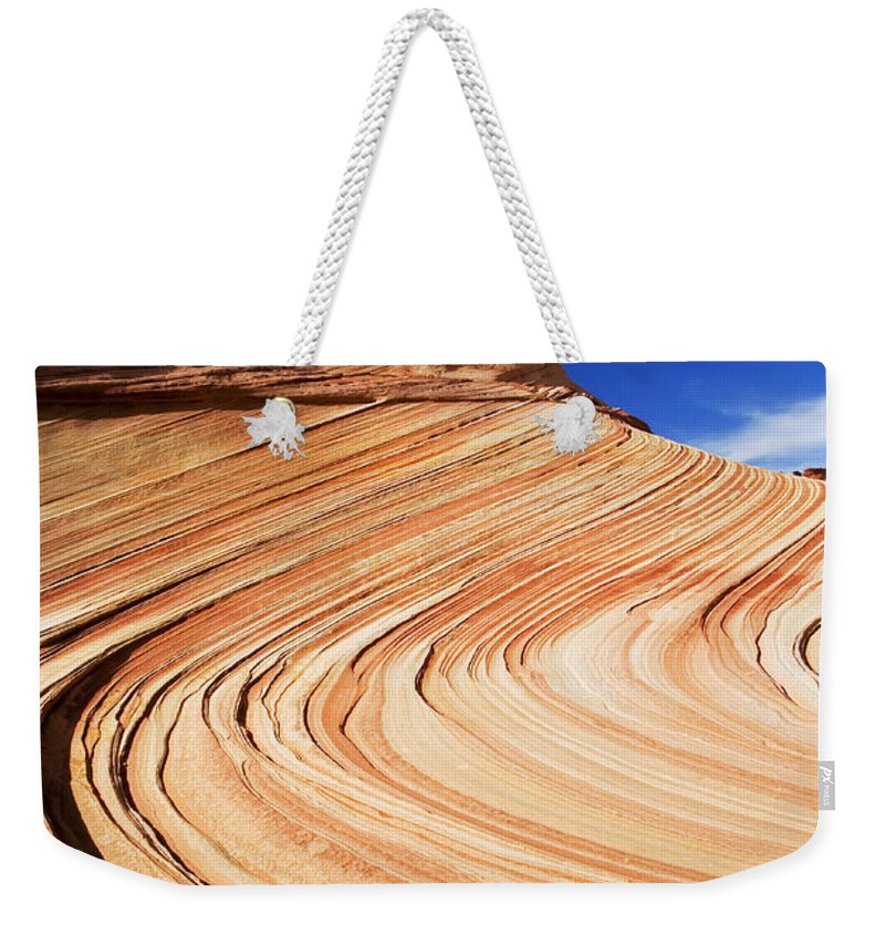 The Wave Weekender Tote Bag featuring the photograph Sandstone Slide by Mike Dawson