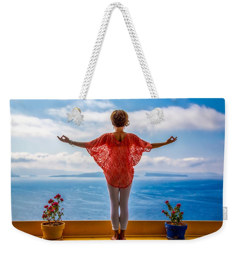 Santorini Weekender Tote Bag featuring the photograph Santorini Yoga Goddess by Stuart Smith