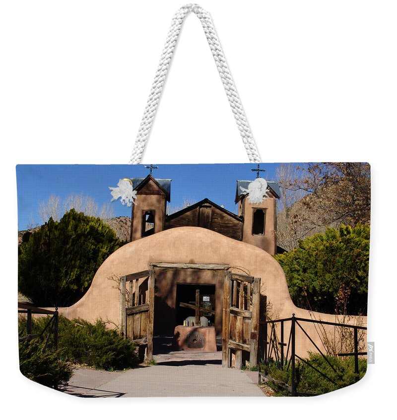 Church Weekender Tote Bag featuring the photograph Santuario De Chimayo Adobe Chapel by Carol Milisen