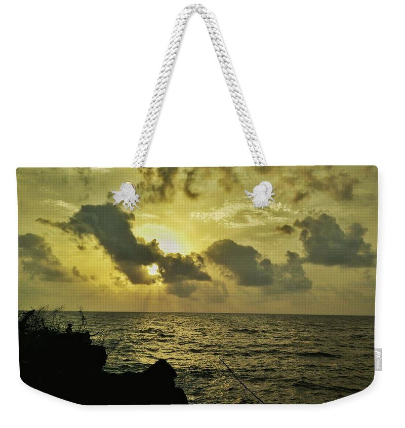 Sunset Weekender Tote Bag featuring the photograph Sarjekot Sunset Point by Evan Dantas