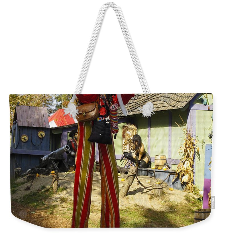 Man Walking On Stilts Weekender Tote Bag featuring the photograph Scarecrow Walking On Stilts by Sally Weigand