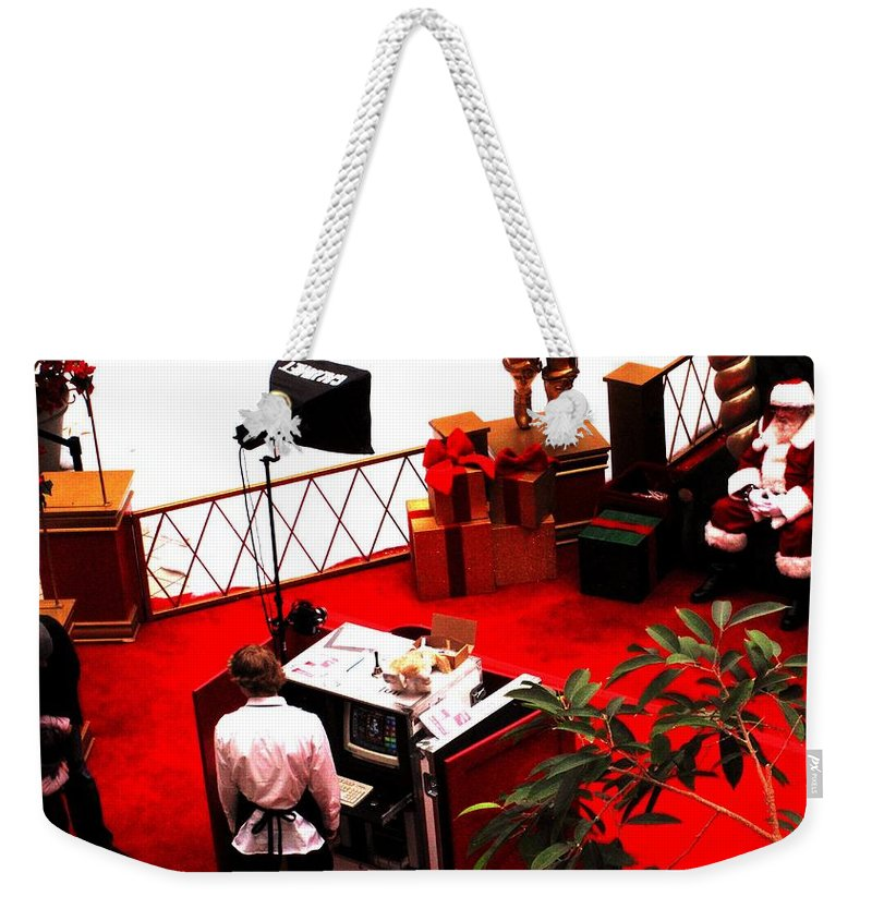 Christmas Weekender Tote Bag featuring the photograph Scarey Old Guy In A Red Suit by Ian MacDonald