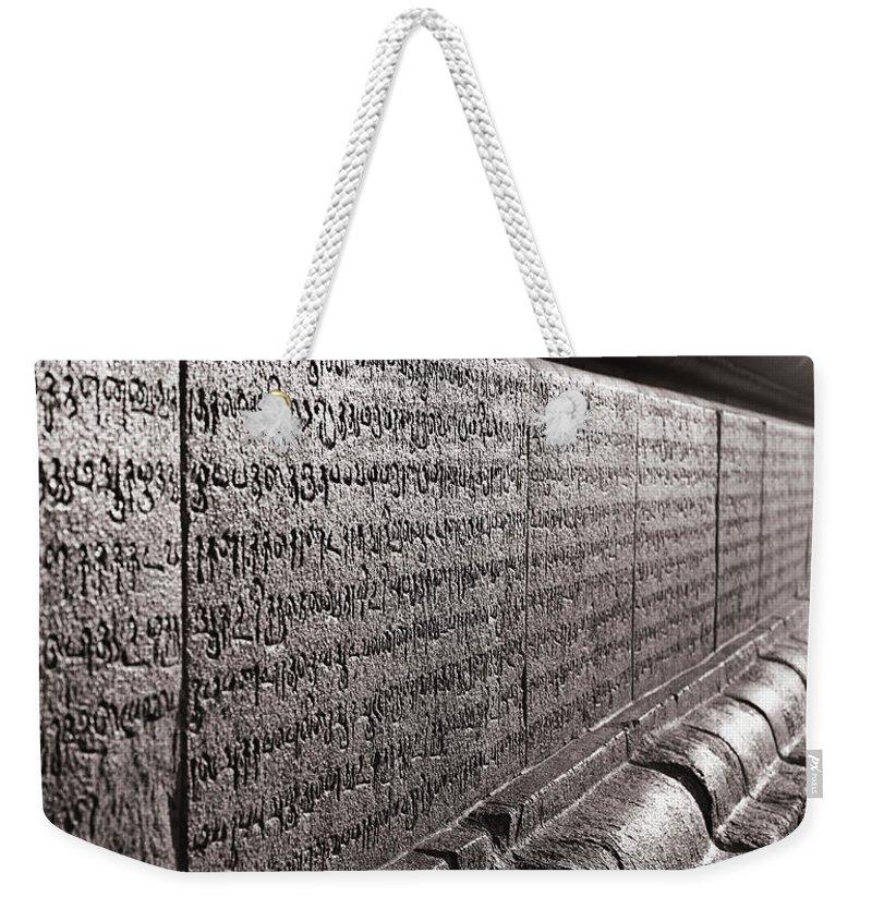 Krishnan Srinivasan Weekender Tote Bag featuring the photograph Scriptures by Krishnan Srinivasan