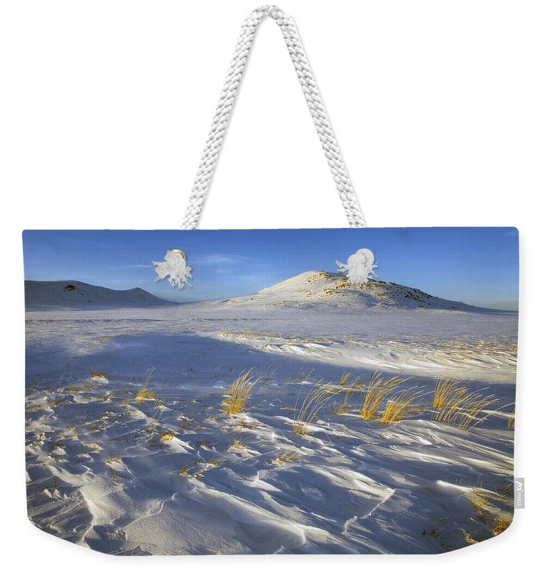 Winter Weekender Tote Bag featuring the photograph Sculpted By The Wind by Mike Dawson