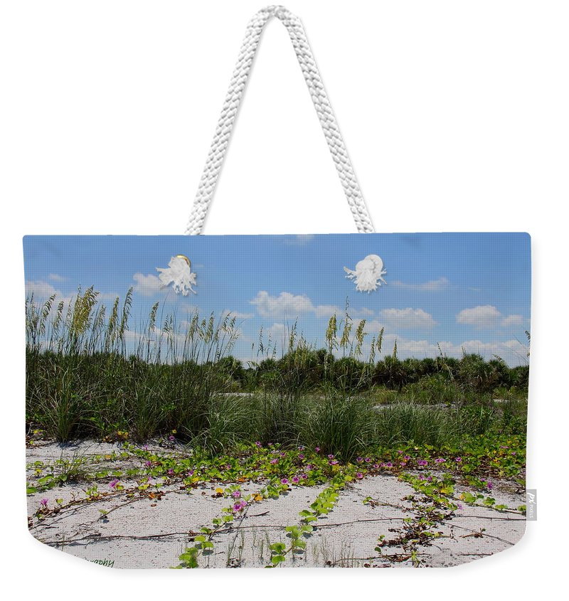 Beach Weekender Tote Bag featuring the photograph Sea Oats And Blooming Cross Vine by Barbara Bowen