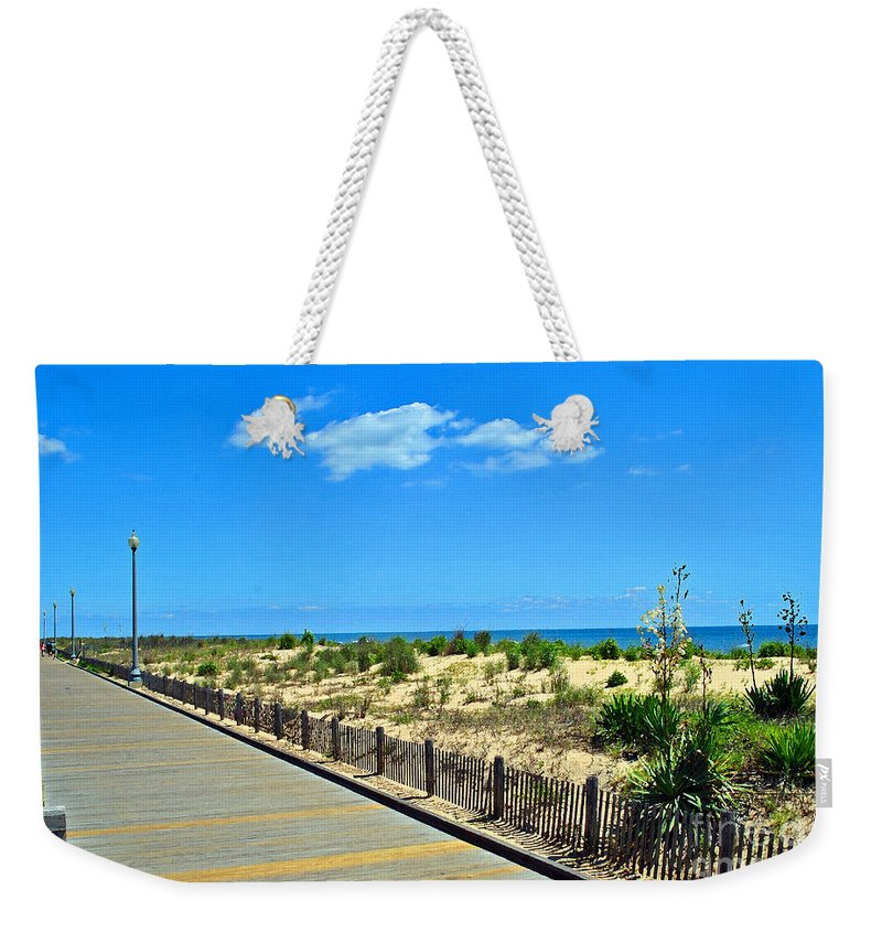 Rehoboth Weekender Tote Bag featuring the photograph Sea Walk by Jost Houk