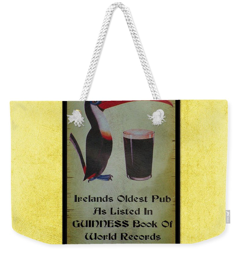 Irish Weekender Tote Bag featuring the photograph Seans Bar Guinness Pub Sign Athlone Ireland by Teresa Mucha