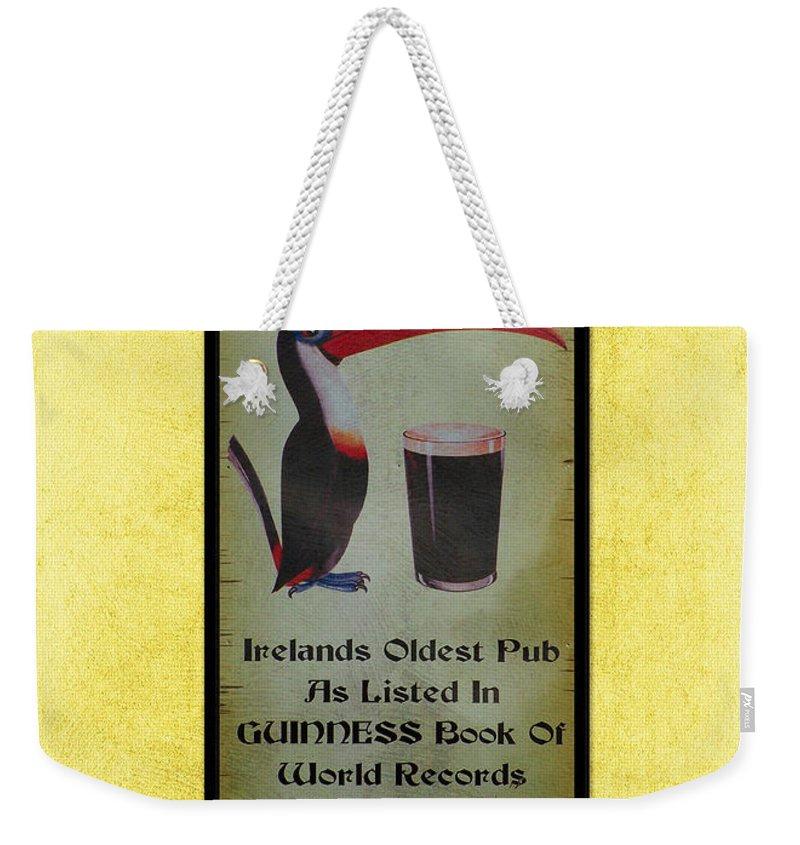Irish Weekender Tote Bag featuring the photograph Seans Bar Guinness Pub Sign Athlone Ireland by Teresa Mucha