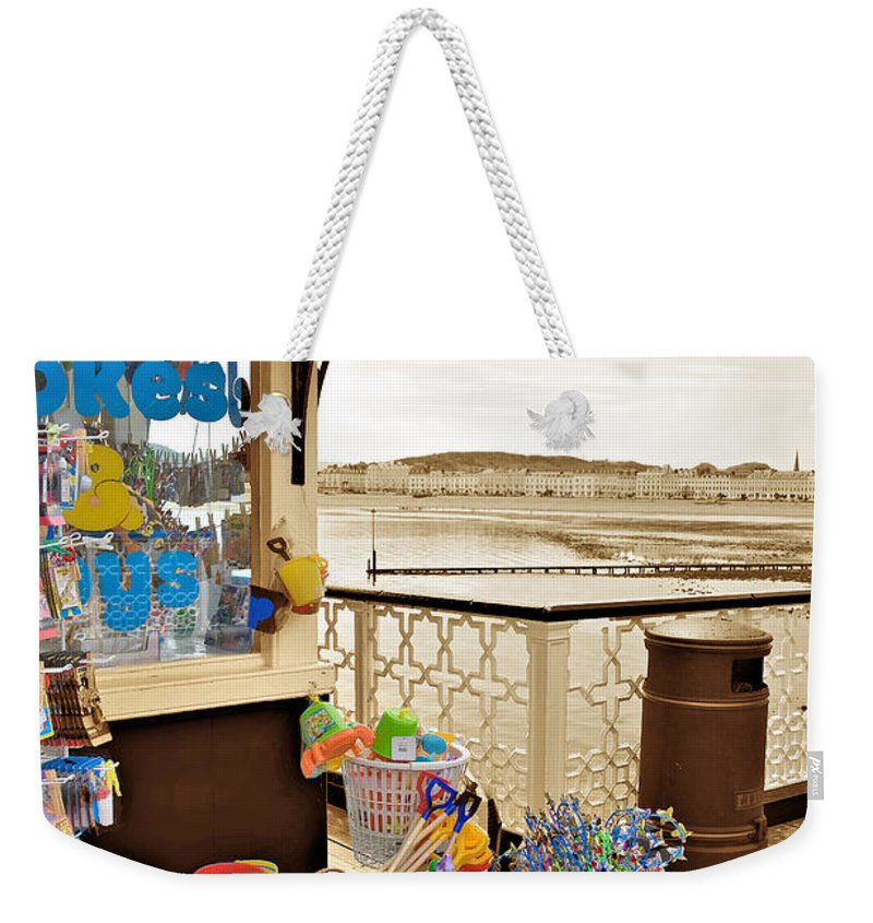 Seaside Weekender Tote Bag featuring the photograph Seaside Buckets And Spades For Sale On Llandudno Pier by Mal Bray