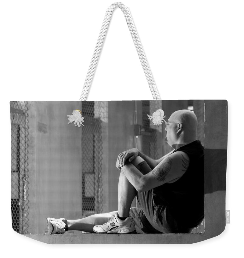 Portrait Weekender Tote Bag featuring the photograph Seated In The Darkness by Angus Hooper Iii