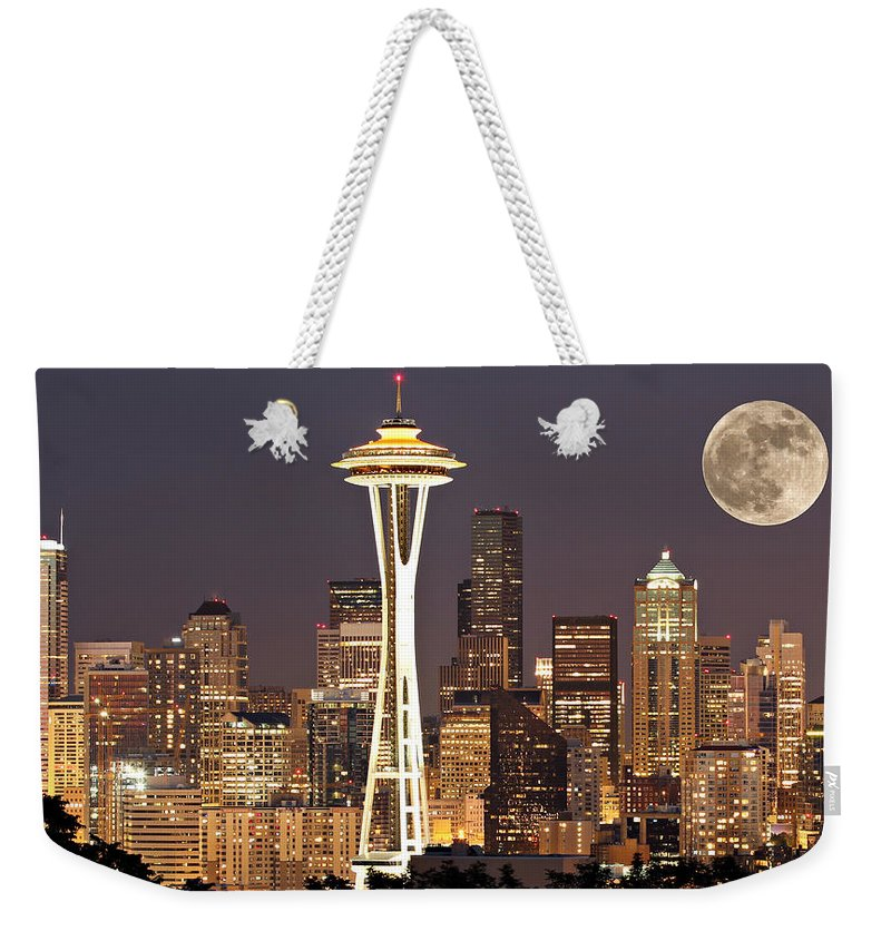 America Weekender Tote Bag featuring the photograph Seattle Full Moon by Paul Fell