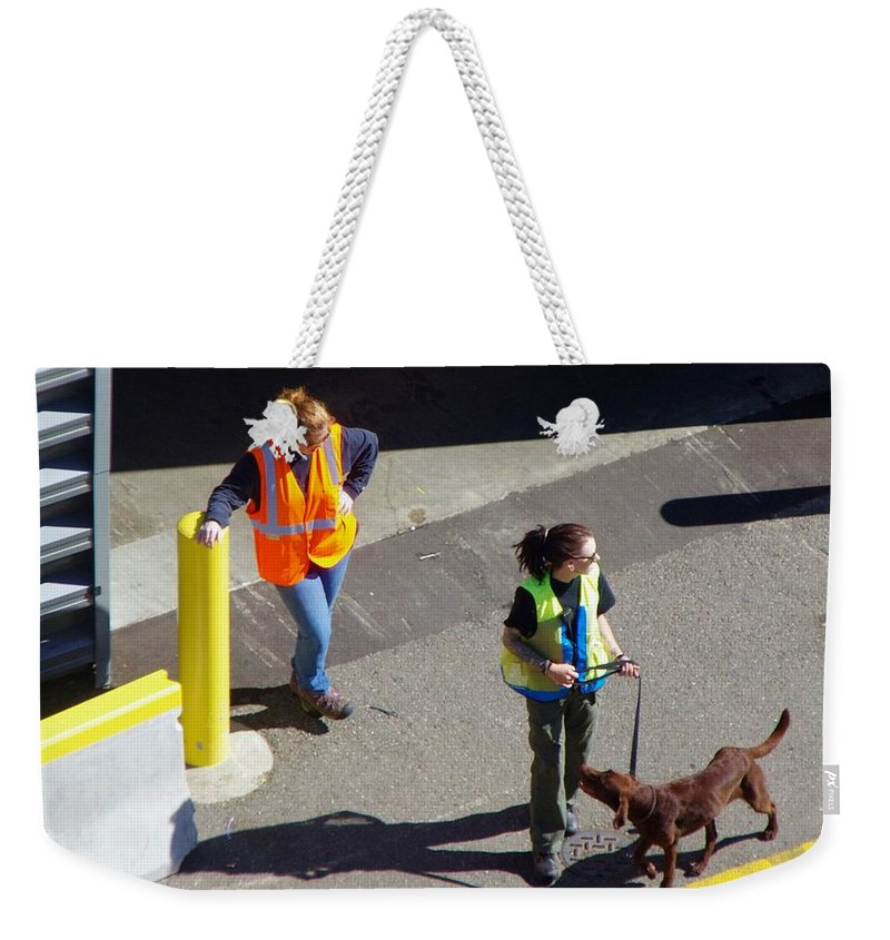 Seatle Weekender Tote Bag featuring the photograph Seattle Dock Dog Workers 1 by Phyllis Spoor