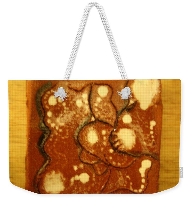 Jesus Weekender Tote Bag featuring the ceramic art Secret Hideout - Tile by Gloria Ssali