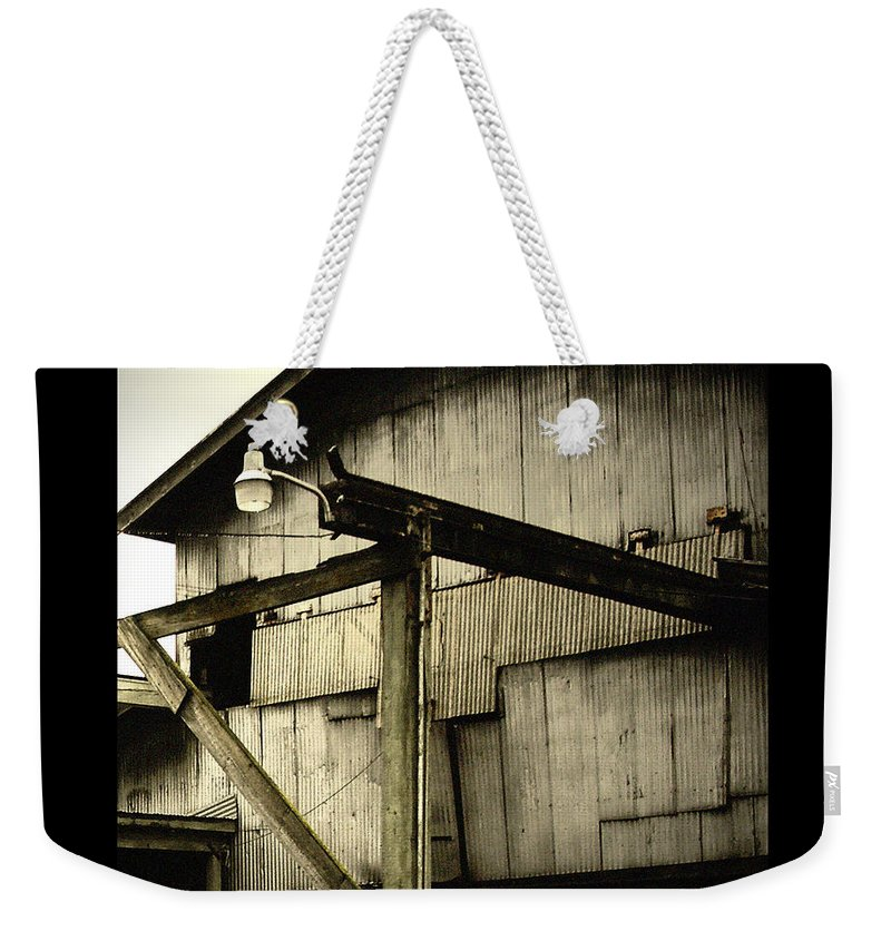 Corrugated Weekender Tote Bag featuring the photograph Security Light by Tim Nyberg