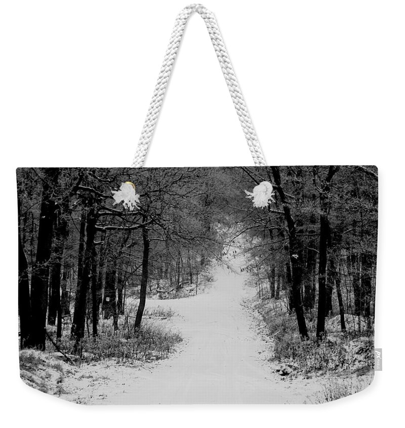 Snow Weekender Tote Bag featuring the photograph See Where It Leads. by Jean Macaluso