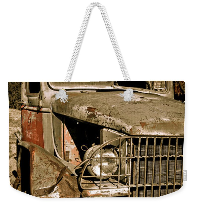 Old Vintage Antique Truck Worn Western Weekender Tote Bag featuring the photograph Seen Better Days by Marilyn Hunt