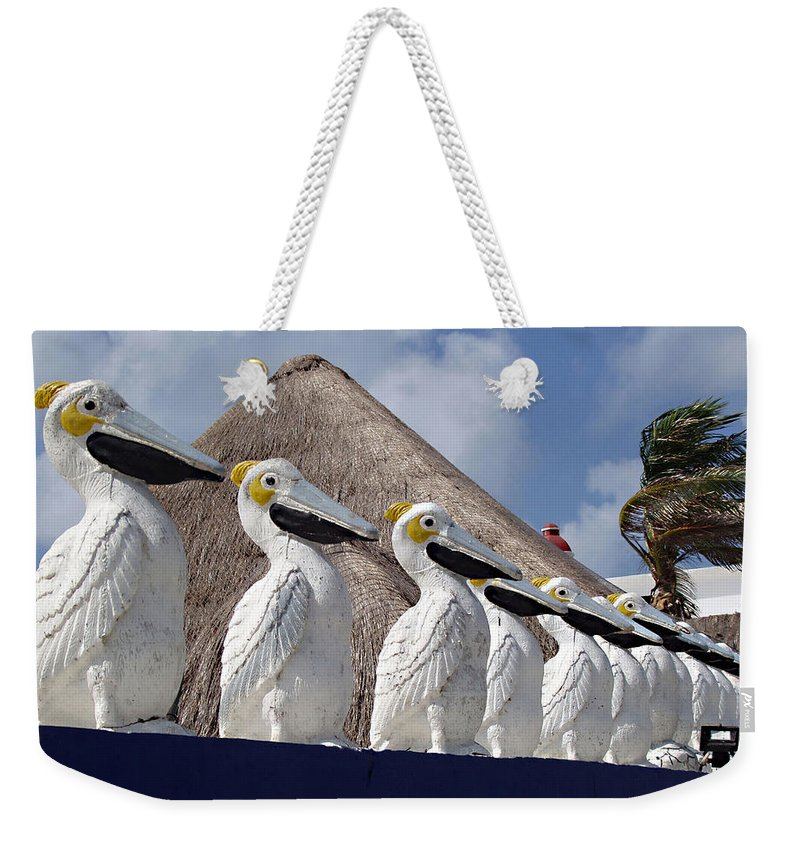 Sentry Pelicans Weekender Tote Bag featuring the photograph Sentry Pelicans by Ellen Henneke