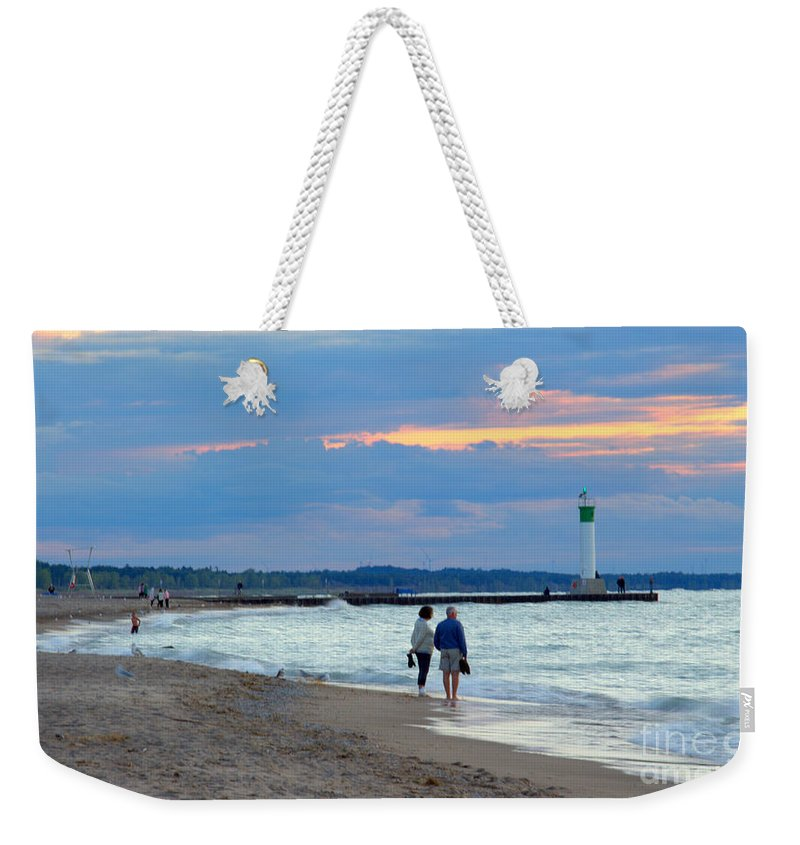 Grand Bend Weekender Tote Bag featuring the photograph September Walk 2 by John Scatcherd