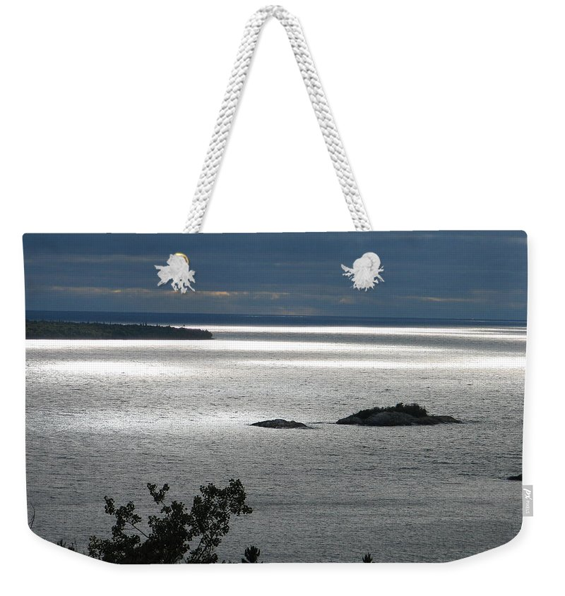 Lake Weekender Tote Bag featuring the photograph Serenity by Kelly Mezzapelle