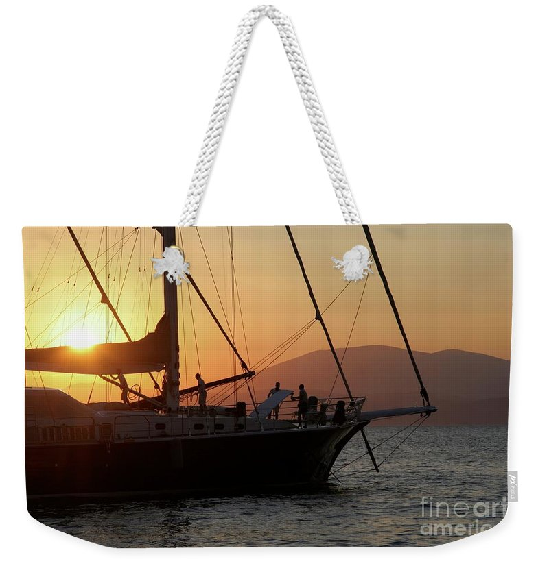 Sunset Weekender Tote Bag featuring the photograph Set Sail On The Aegean At Sunset by Clay Cofer