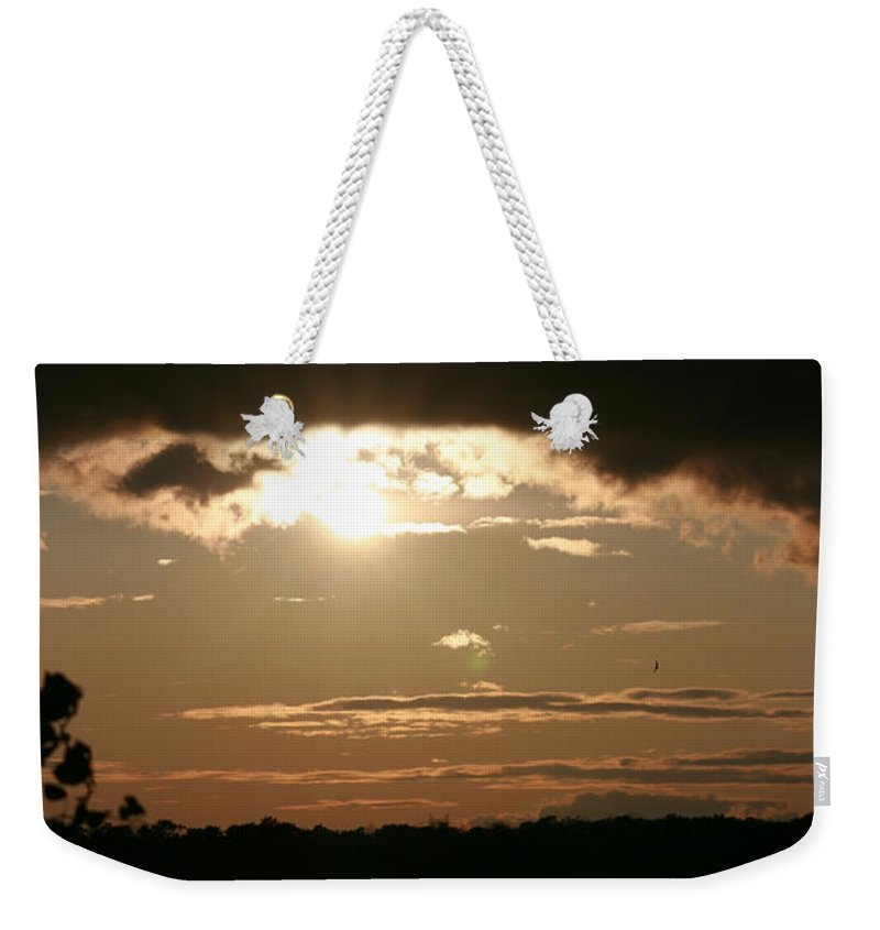 Sunset Lake Water Trees Rocks Shore Clouds Weekender Tote Bag featuring the photograph Setting Sun by Andrea Lawrence