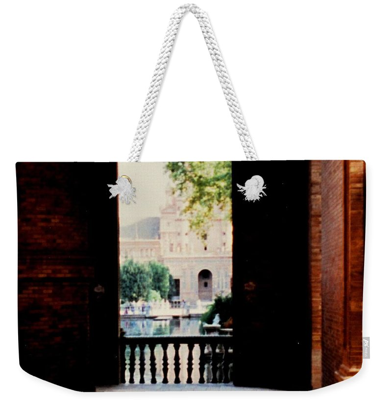 Seville Weekender Tote Bag featuring the photograph Seville by Ian MacDonald