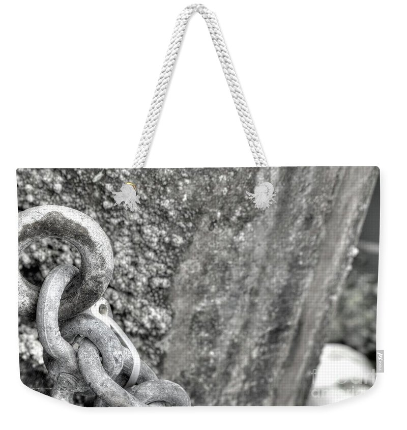 Abstract Weekender Tote Bag featuring the photograph Shackled Not Chained by Dorothy Hilde