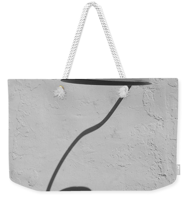 Black And White Weekender Tote Bag featuring the photograph Shadow Lamp by Rob Hans