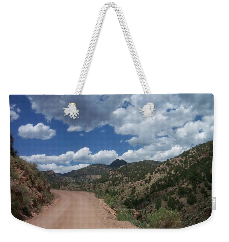 Shelf Road Weekender Tote Bag featuring the photograph Shelf Road by Anita Burgermeister