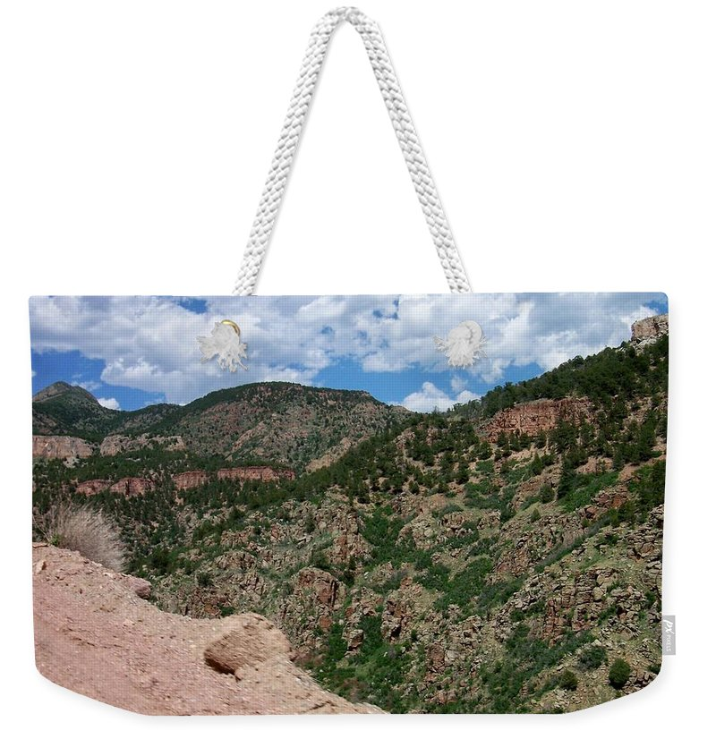 Shelf Road Weekender Tote Bag featuring the photograph Shelf Road drop off by Anita Burgermeister