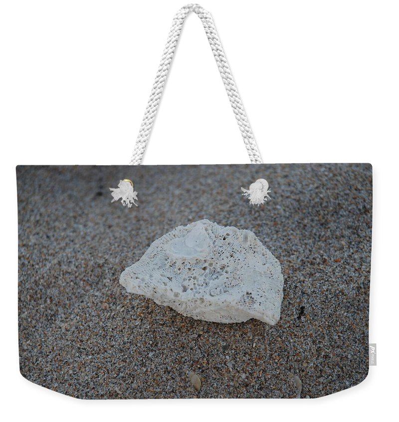 Shells Weekender Tote Bag featuring the photograph Shell And Sand by Rob Hans