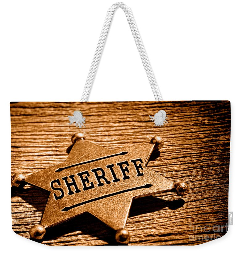 Sheriff Weekender Tote Bag featuring the photograph Sheriff Badge - Sepia by Olivier Le Queinec