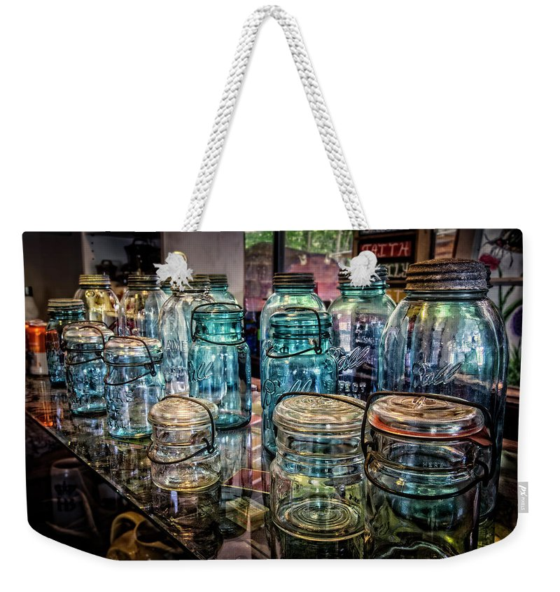 Appalachia Weekender Tote Bag featuring the photograph Shiny Glass Jars by Debra and Dave Vanderlaan