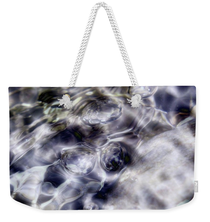 Water Weekender Tote Bag featuring the photograph Shore Bubbles by Jeff Swan