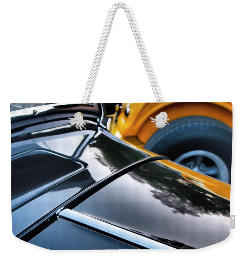 Showdown Weekender Tote Bag featuring the photograph Showdown by Skip Hunt