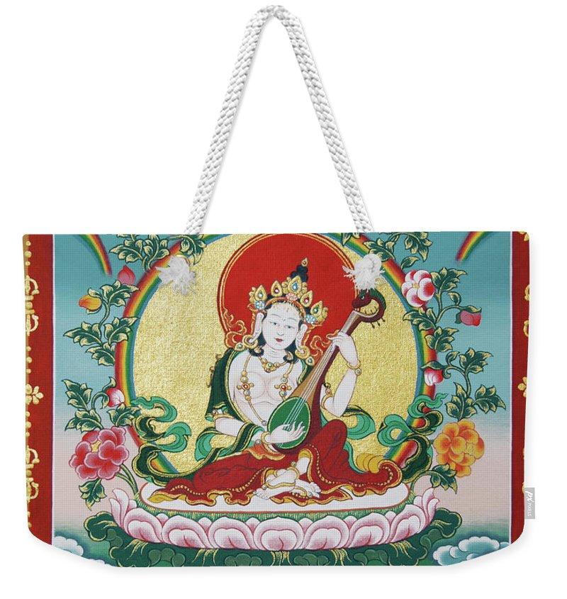 Shri Saraswati Weekender Tote Bag featuring the painting Shri Saraswati - Goddess Of Wisdom And Arts by Sergey Noskov