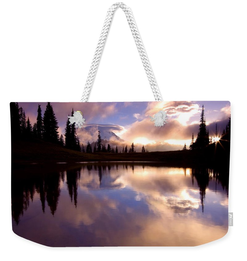 Rainier Weekender Tote Bag featuring the photograph Shrouded In Clouds by Mike Dawson