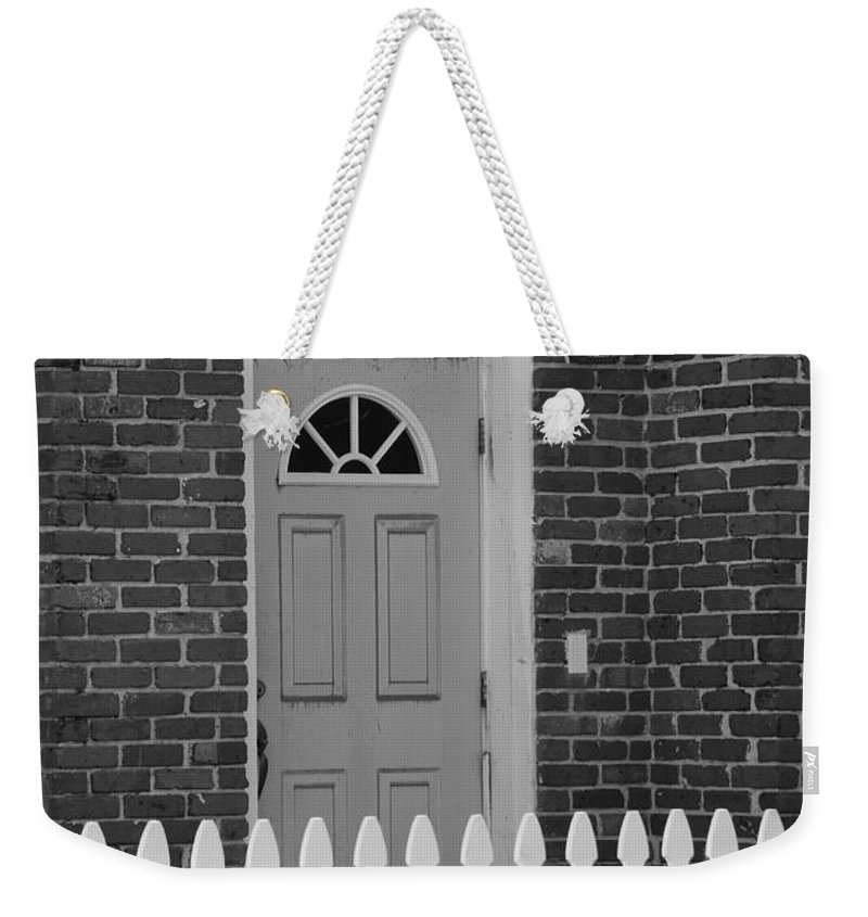 Black And White Weekender Tote Bag featuring the photograph Side Door by Rob Hans