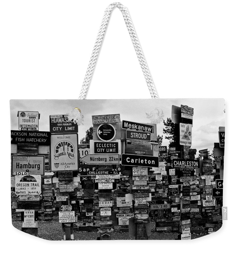 North America Weekender Tote Bag featuring the photograph Sign Post Forest by Juergen Weiss